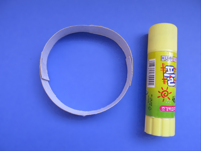If you are making a napkin ring glue the ends of one slice together If you are making a bracelet glue 2 together to make a ring big enough to slide over your hand.