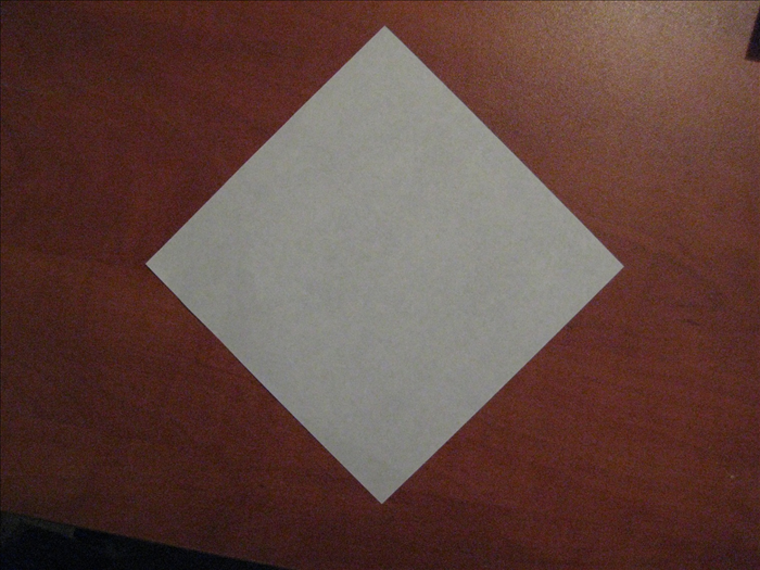 Place paper with the colored side facing down.  The points should be on the top, bottom and sides.