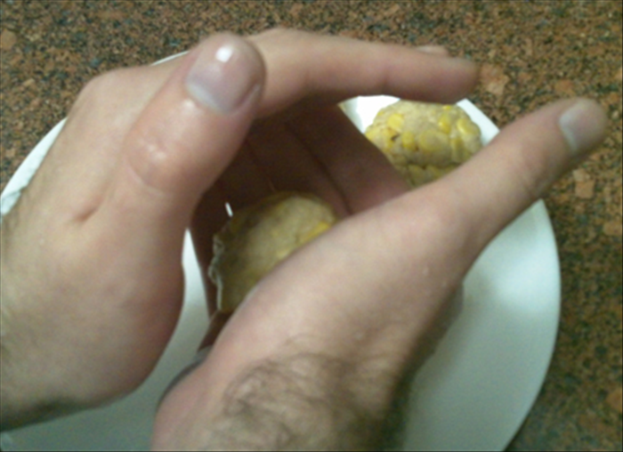 Wet your hands and form flattened balls with 2 tablespoons of the mixture