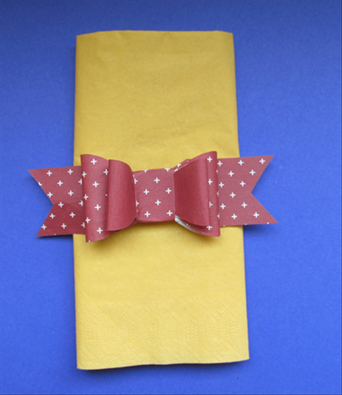 Glue the bow to the band you just made And your napkin ring is ready!