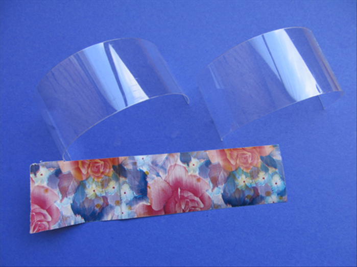 Cut 2 strips of the plastic and 1 strip of the paper  - 1 ½ inches wide  and  6 inches long