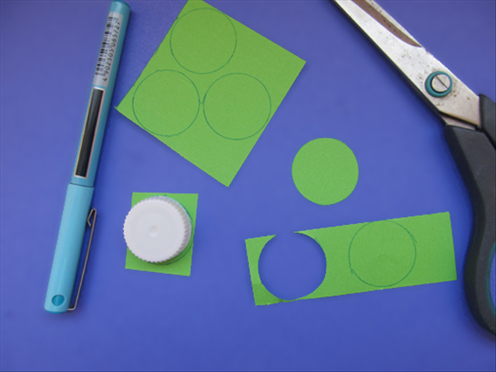 <p> Trace the bottle cap 6 times on colored paper.</p>  <p> Cut out the circles.</p>  <p>  </p>