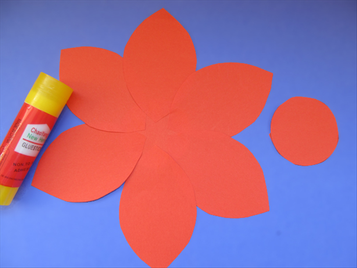 <p> Glue them to the circle with the same side of each petal overlapping.</p>   <p> Glue the second circle to the center.</p>   <p> &nbsp;</p>