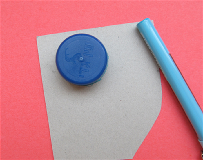 On a piece of cardboard draw a circle around the bottle cap or small circular object
