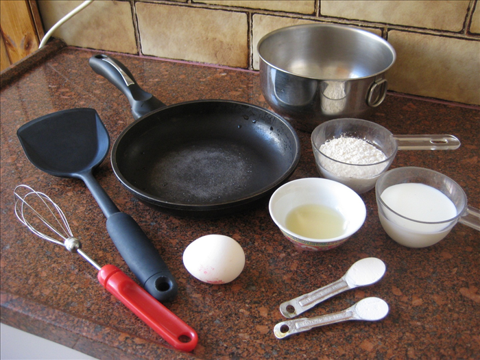 Take out all the tools and ingredients you need to make the pancakes.