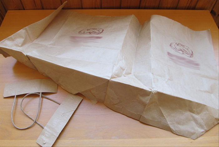 Open the paper bag and remove the handles