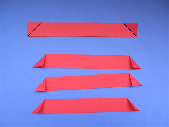 <p> Carefully fold down the top points of the strips to align with the bottom edge.  </p>  <p> *Make sure the bottom of the crease starts at the corner.</p>   <p>  </p>