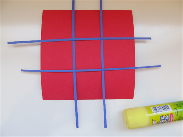 <p> Place 2 strips horizontally and 2 strips vertically. Adjust them to make 9 equal squares.</p>  <p> Glue them in place.</p>  <p>  </p>