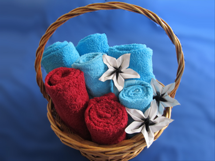 You can display or set up a gift basket with towels rolled to different heights.  If you are standing up the towels in a basket, keep the neat folded end on the top and the open edge in the back.  If you are laying them on top of each other, on a shelf, put the neat folded end in the front and place the open end on the bottom.  Enjoy!