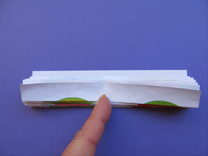 Continue folding the paper accordion style until you get to the top