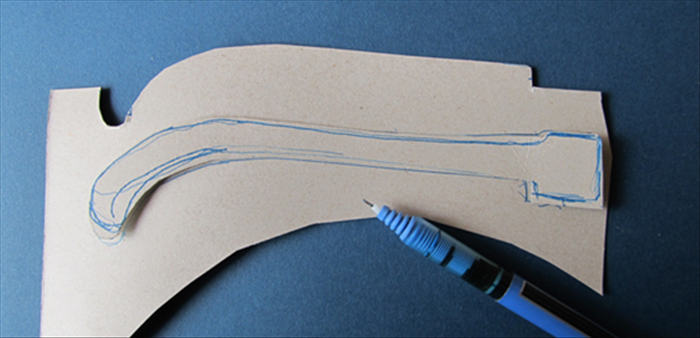 <p> Trace the cut out onto another piece of cardboard and cut out the second piece.</p>