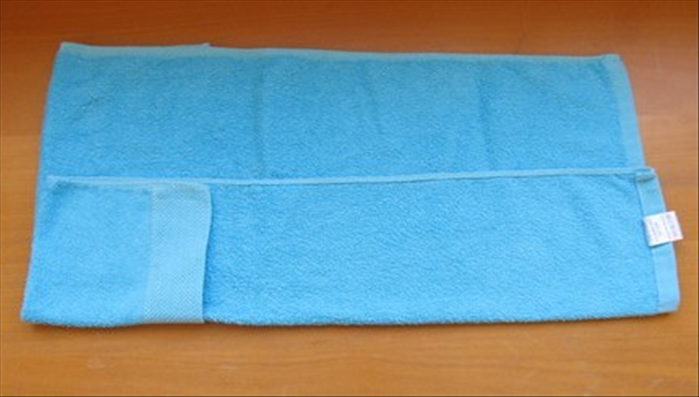 Flip the towel over to the back side.