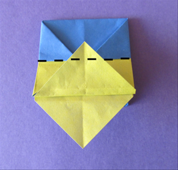 Fold the layer you just made up along the edge of the bottom side triangles.