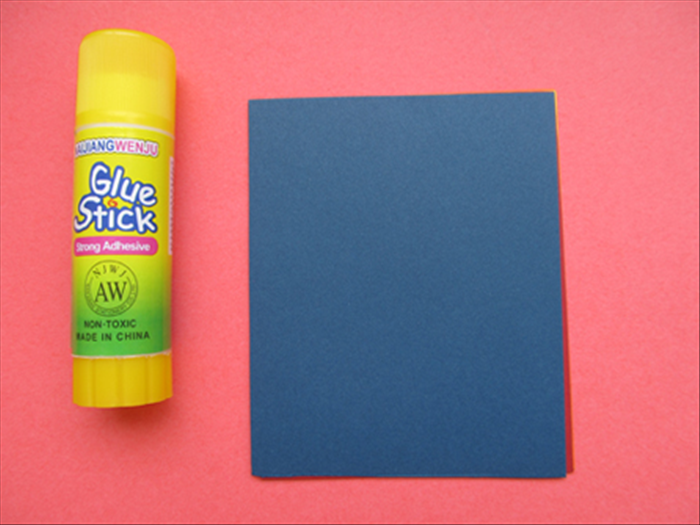 Use only a small line of glue at the top of each colored paper to hold them together.