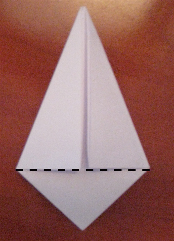 Fold the bottom point up along the straight edge of the  folds you made in the last step.