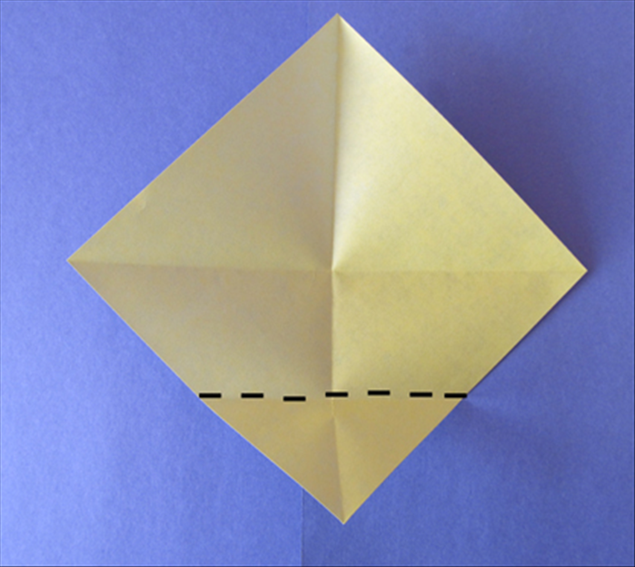 Fold the bottom point up to the center.