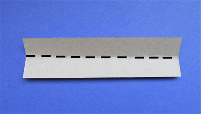 Take the 1 ½ inches x 5 ¾ inches strip and fold it in half lengthwise