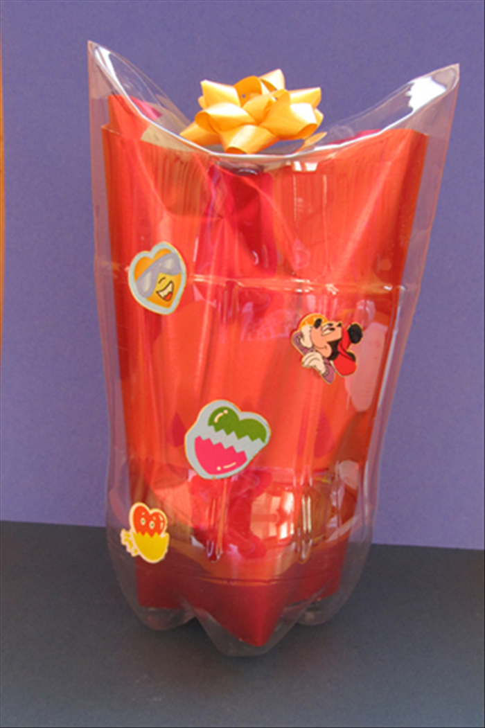 Materials: Plastic bottle Small plate Pen or object with a sharp point Optional wrapping paper, tissue paper or colored paper Bows and stickers
