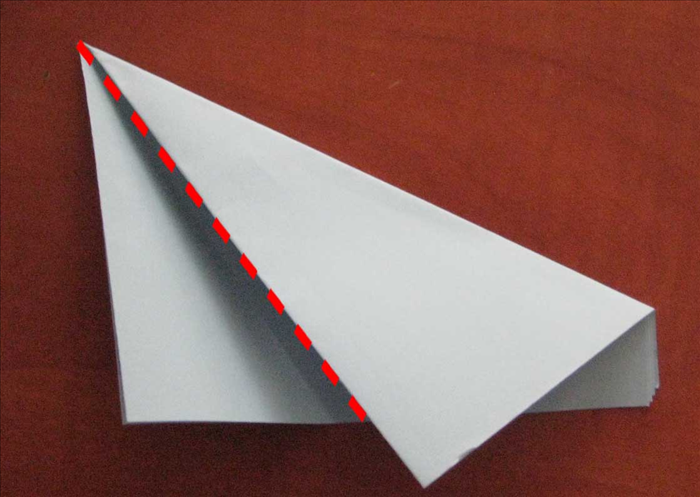 The top edge you are bringing down should be placed so that it makes these 2 triangles the same width.  Bring the left side up to align with the right edge. These 2 layers should be the same width. and make the paper folded in thirds.