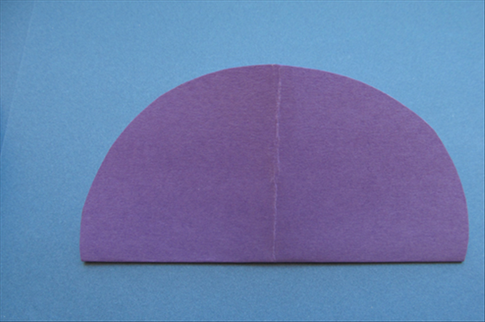 Use the crease line as a guide to fold it in half in the opposite direction