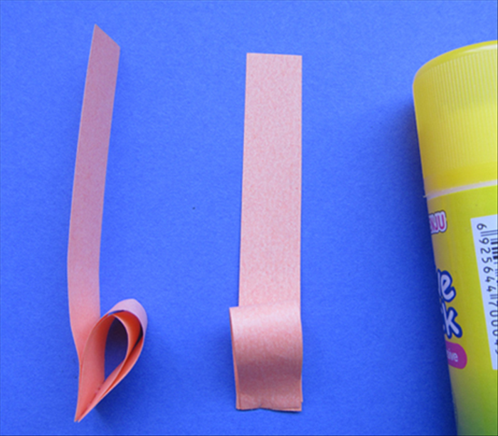 Align the straight edges with the last 2 strips and glue them in place- at the bottom only
