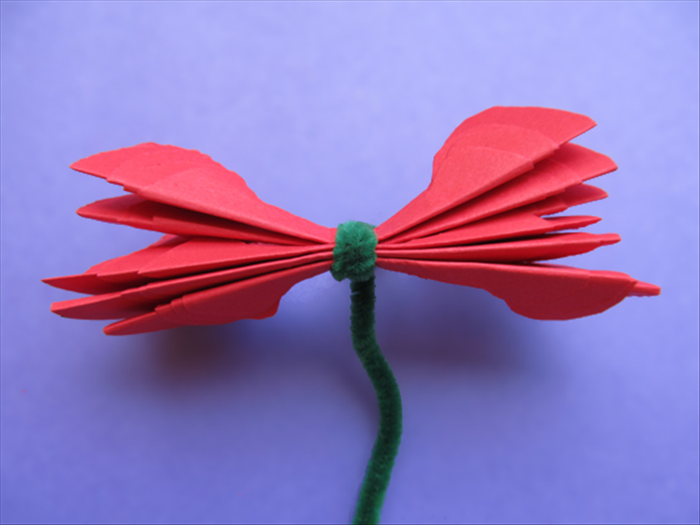 Place the 6 grouped petals on top of each other facing the same way. Wrap the wire or string tightly around the center
