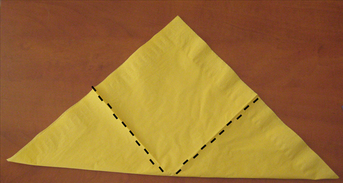 Fold the 2 bottom points up to the top point.