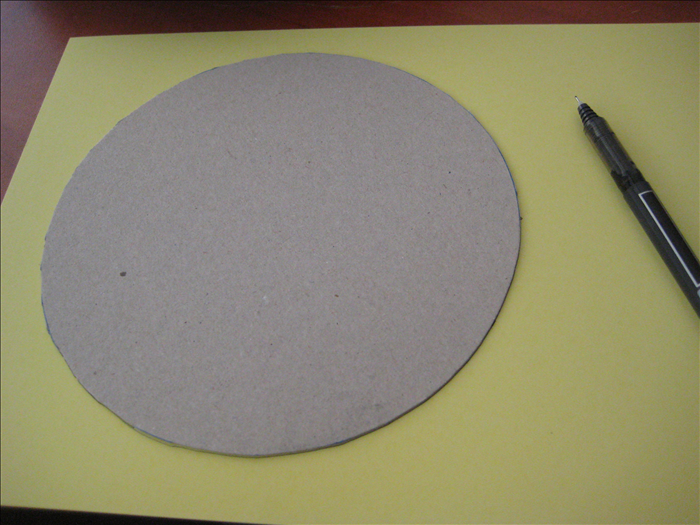 Trace and mark the cardboard circles you made on decorative paper.