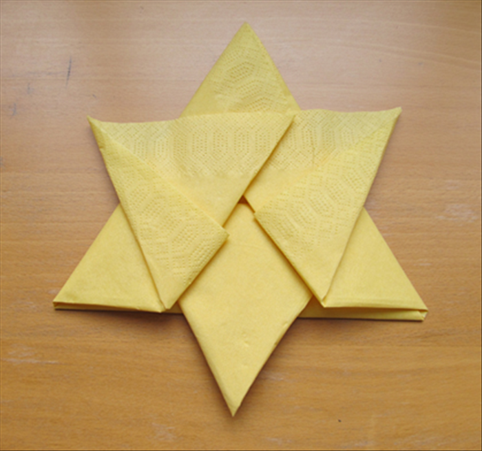 Result  You can leave the star as it is. Just carefully flip it over and put it on a plate   or you can continue 2 more steps to make a more secure fold