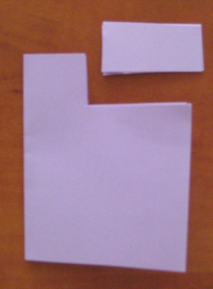 Rotate the paper so that the folded edge is at the right side.  Starting from the open end, cut out the 2 layers from the top approximately ¼ of the way up and 2/3 of the way in