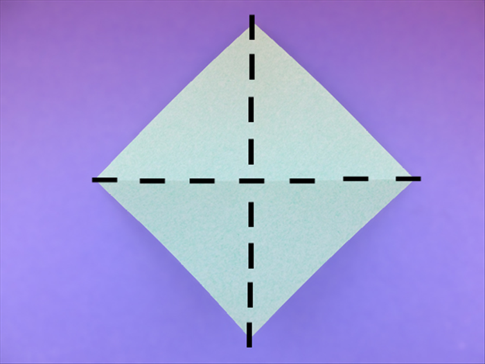 <p> Hold the paper with the points at the top, bottom and sides.</p>  <p> Bring the top and bottom points together to fold it in half. Unfold.</p>   <p> Bring the sides points together to fold it in half. Unfold.</p>   <p>  </p>