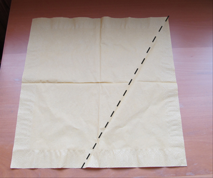 Unfold the napkin  Bring the right bottom corner up to the middle crease  See next picture for result