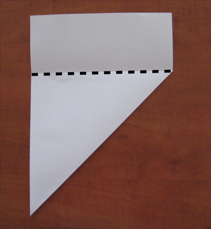 Cut along the top edge of the folded layer.
