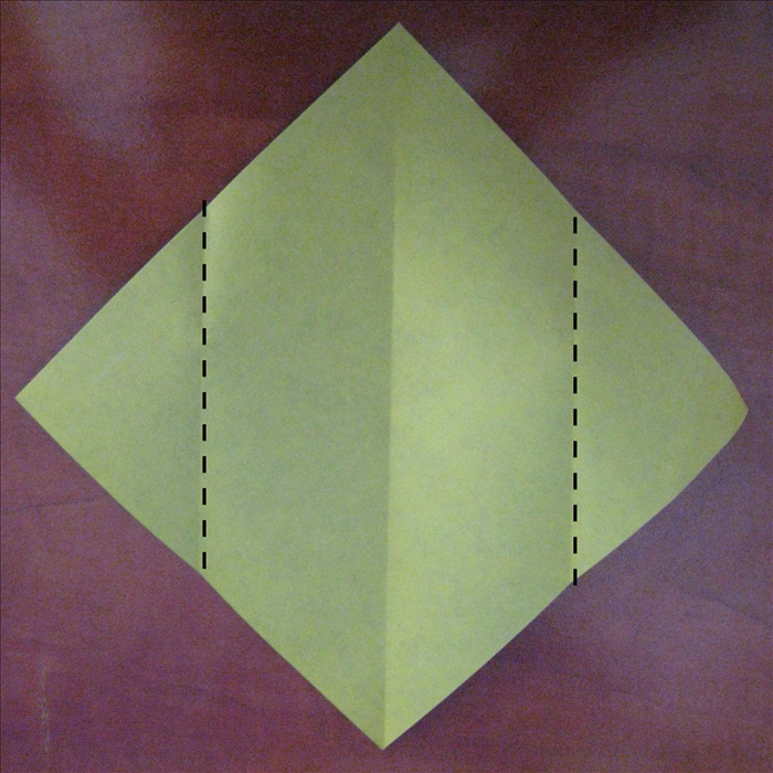 Fold the 2 side points to the center crease you just made.