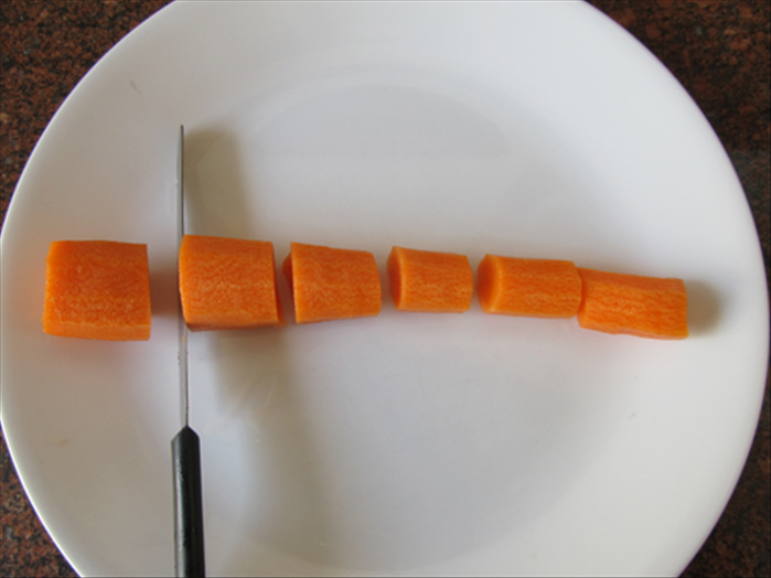 Peel, wash and cut off the ends of the carrot.  Cut the carrot into about 1 inch pieces