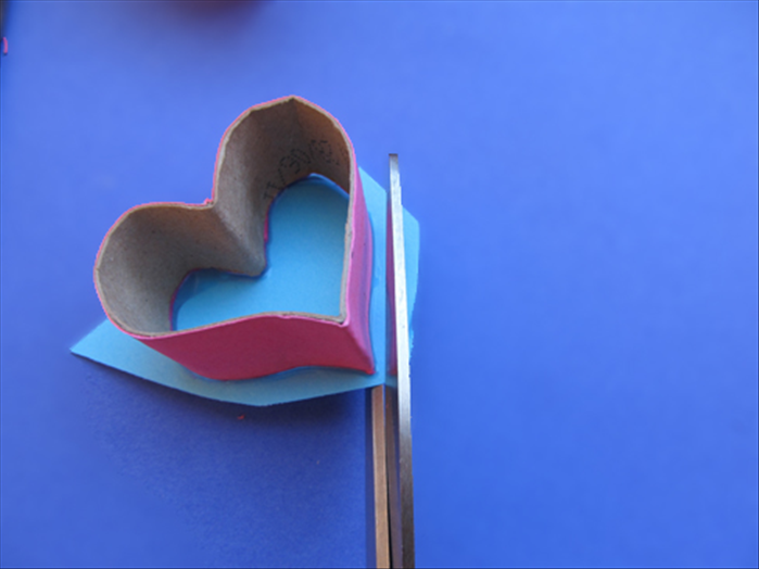 Cut the extra paper off along the edge of the heart shape.