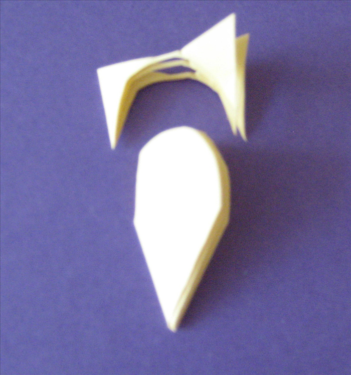On the same paper cut a half oval starting from 1/3 – 1/2 of the way from the top Continue cutting the top of the oval as close to the top as you can. Try to make the ½ oval shape equal on both sides.