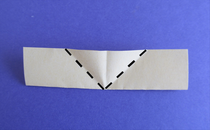 Hold the paper so that the folded edge is on the bottom. Bring the bottom edges up to align with the center crease