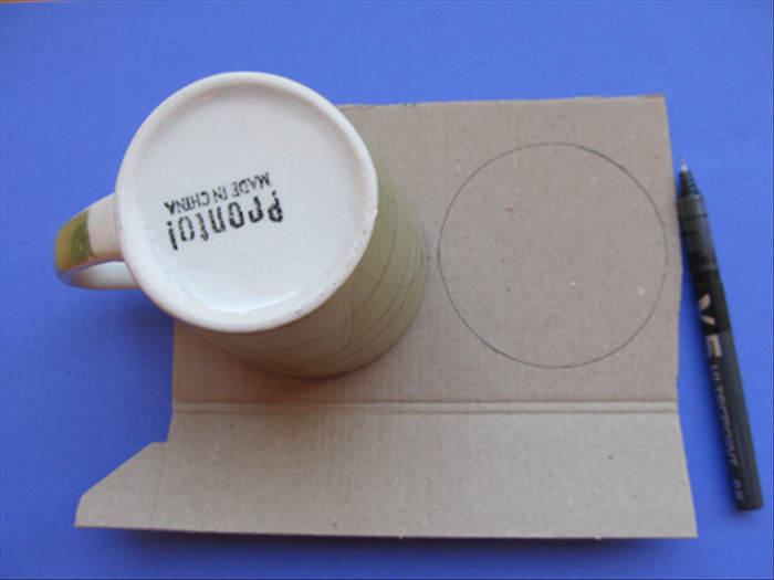 Trace the large cup or similar sized round object 2 times on cardboard. Cut out the 2 circles