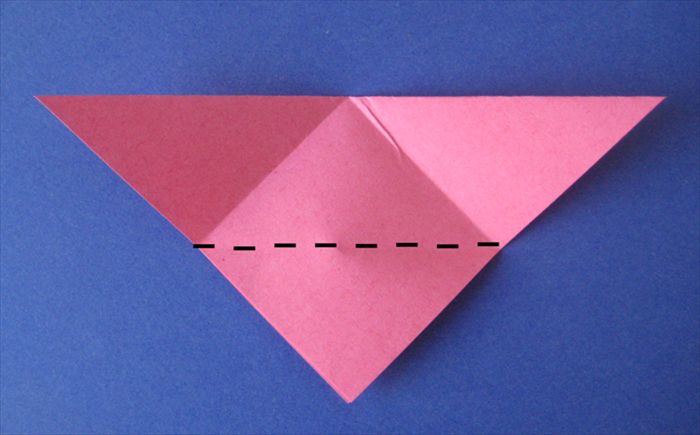 Fold the bottom point up to the top edge.