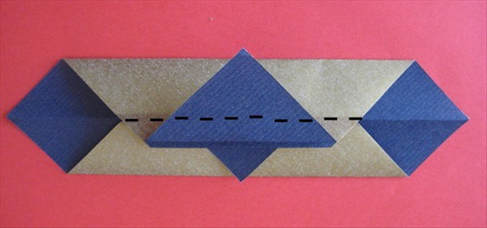 Fold the top flap along the center crease underneath.