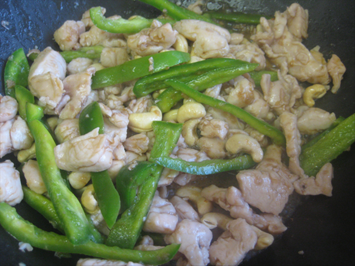 Add the cashews and wine and sugar vinegar mixture Stir fry 2 minutes