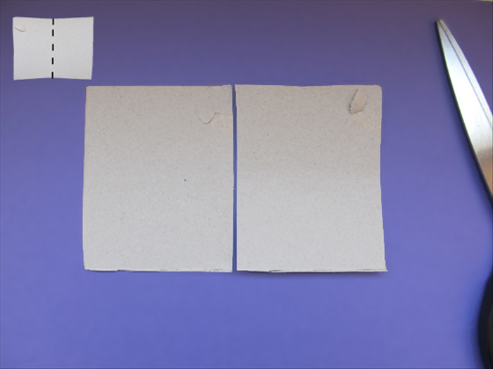 <p> Fold a rectangle of cardboard in half.</p>  <p> Cut along the crease.</p>  <p>  </p>