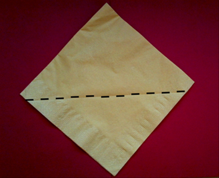 Take a paper napkin as it comes folded in the package or fold a cloth napkin in half horizontally and again vertically.