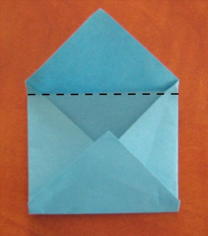 Fold the top point down from slightly below the top edges of the side folds.