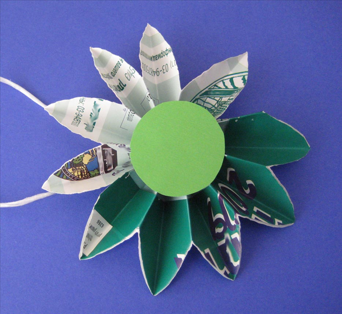 Your daisy is finished. You can hang one or make many into a chain or flower bouquet