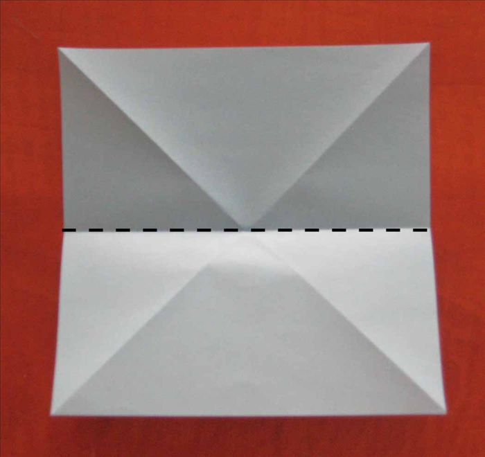 Flip the paper over to the back side.  Fold the paper in half horizontally and unfold