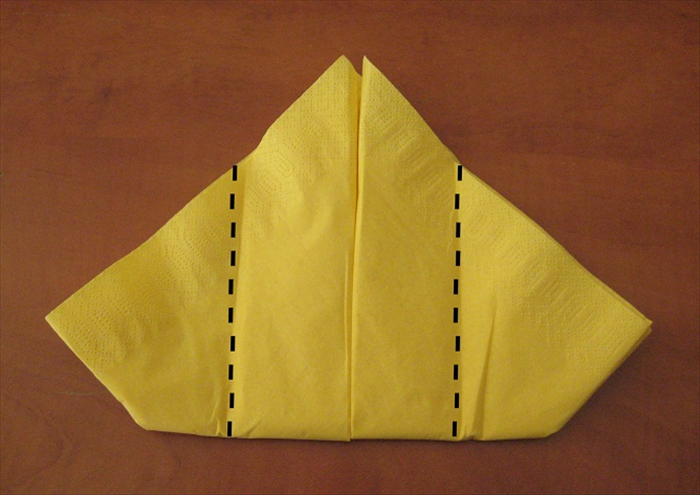 Flip the napkin over to the other side.