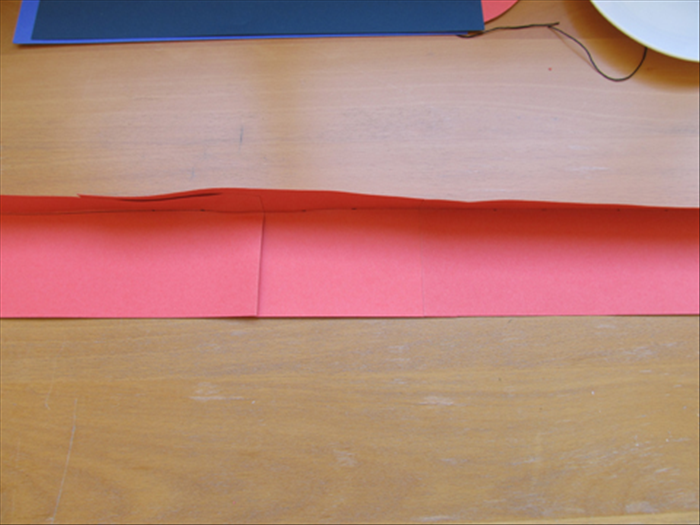 Make a sharp neat crease along the line you drew. Unfold