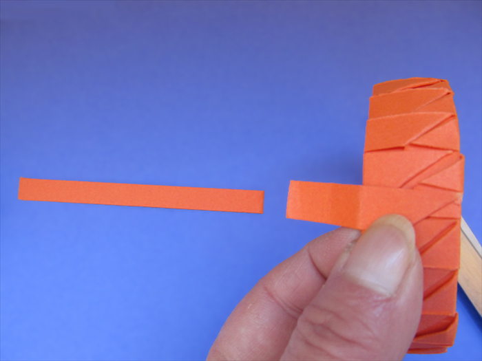 <p> When you have completely covered the band, the last strip should align inside of the band.</p>  <p> Unfold the last fold, put glue on it and refold.</p>  <p>  </p>